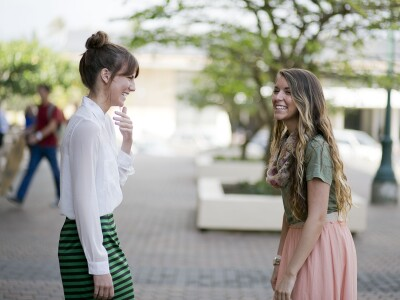 Image of two female students talking and laughing