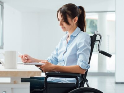 Image of a woman in a wheelchair.