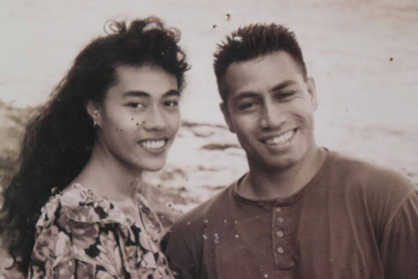 The Talenis smile together in their youth in a black and white photo.