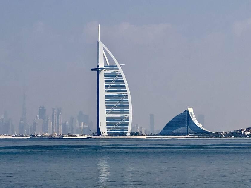 The Burj Al Arab in Dubai with the Dubai skyline in the background.