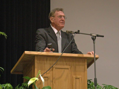 Image of a man speaking from a pulpit.