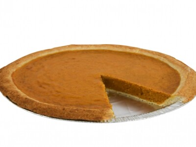 Tin of pumpkin pie with a slice taken out
