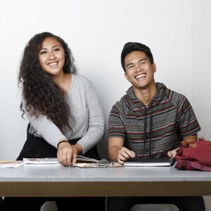 A Samoan female student and a Filipino male student laughing at the camera.