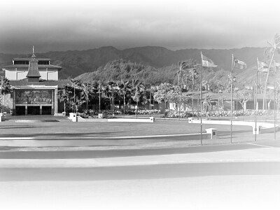 A black and white photo of the McKay Building and flag circle