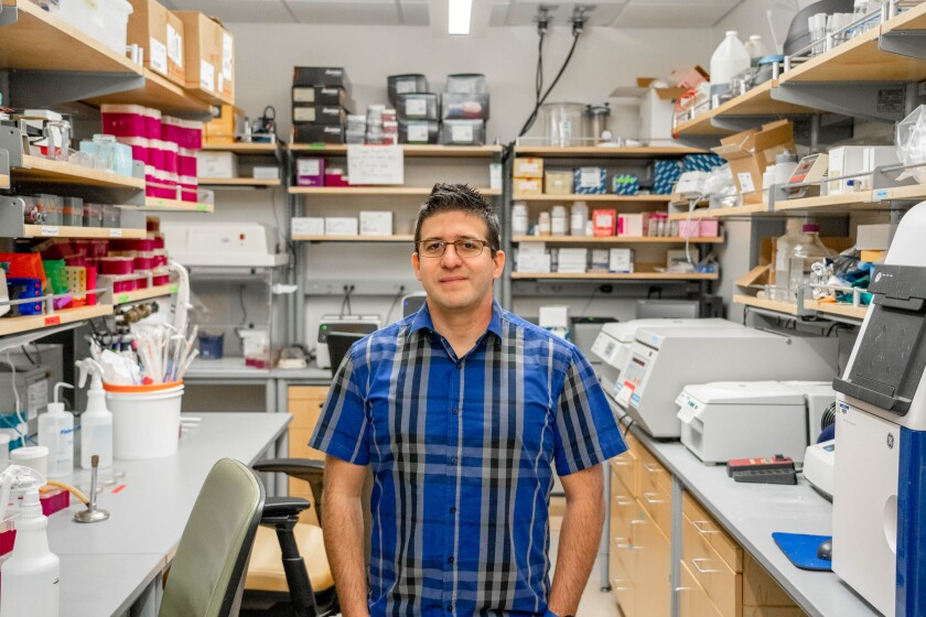 Israel Guerrero stands in lab for photo.