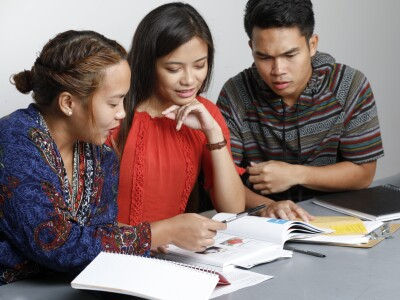 Image of multicultural students studying together