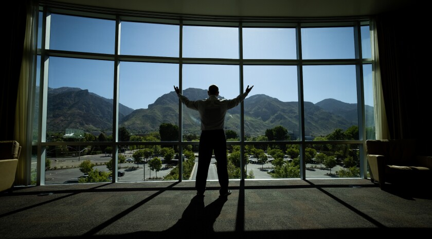 Professional portrait of Bill Cope in front of a window overlooking BYU campus.
