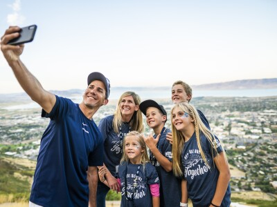 Image of family taking a selfie at the top of the Y hike