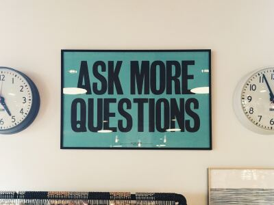 sign that says: Ask More Questions