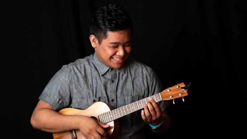 Keanu Dellona plays his ukulele.