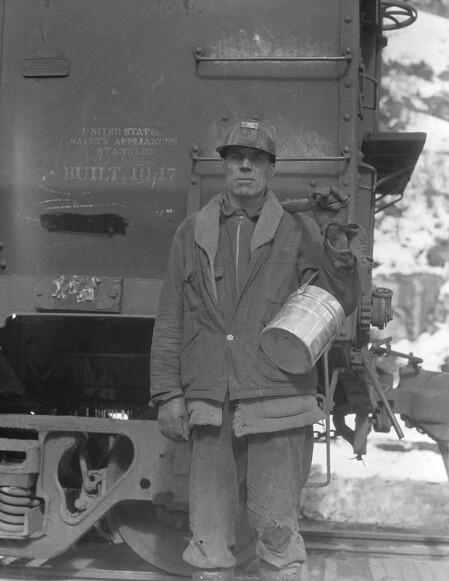 Utah Miner working for the Blue Blaze Mine in Carbon County holds his dinner pail (Photograph by Dorothea Lange)
