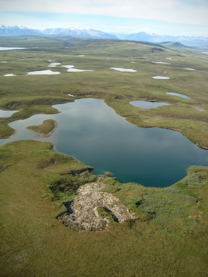 Permafrost collapse is characterized by soil collapsing into rivers and/or large craters.