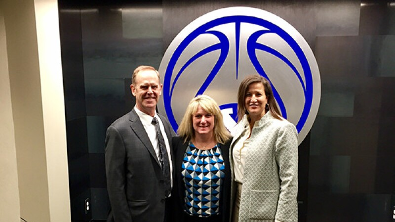 NCAA Director Amy Wilson with BYU Athletic Director Tom Holmoe and Associate Athletic Director Liz Darger