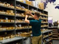 Warehouse student organizing stock