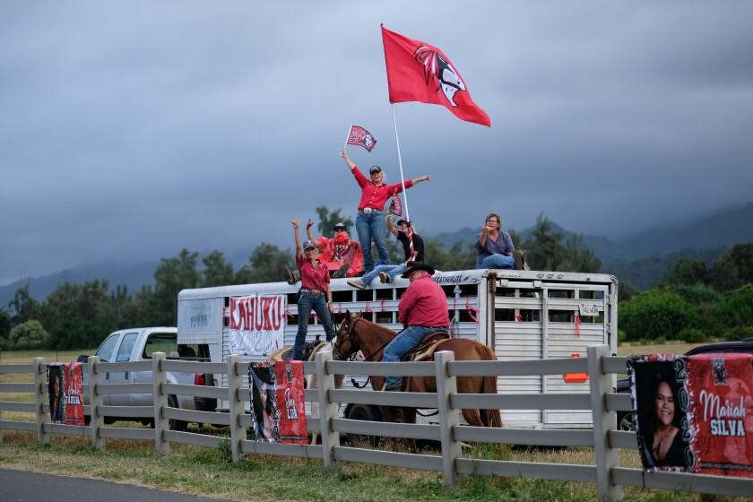 People at Gunstock Ranch celebrate with Kahuku Red Raiders apparel.