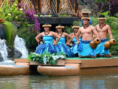 Image of Polynesian Cultural Center performers dancing on a canoe