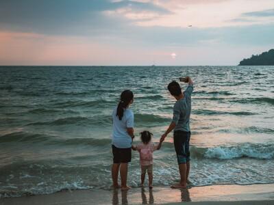 A family take selfie on the beach