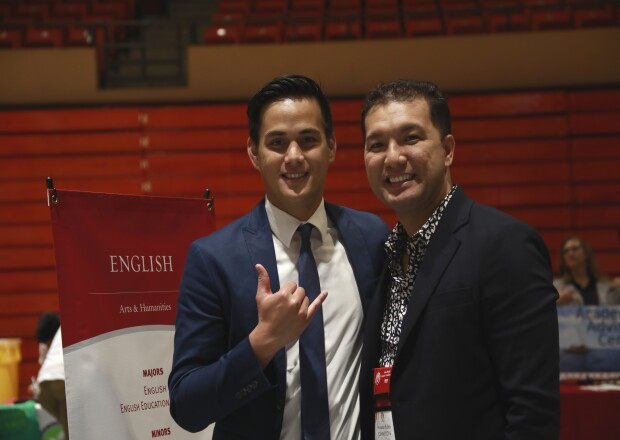 Image of BYUH alumni with a BYUH student from the APCC 2019