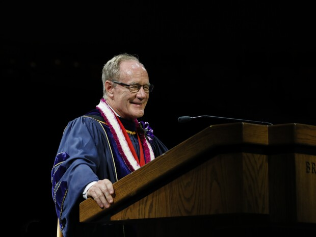 President Tanner standing at the podium giving a graduation speech.