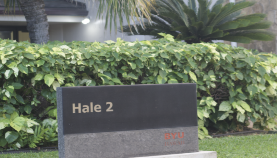 "The entrance sign in front of Hale 2 that reads ""Hale 2."""