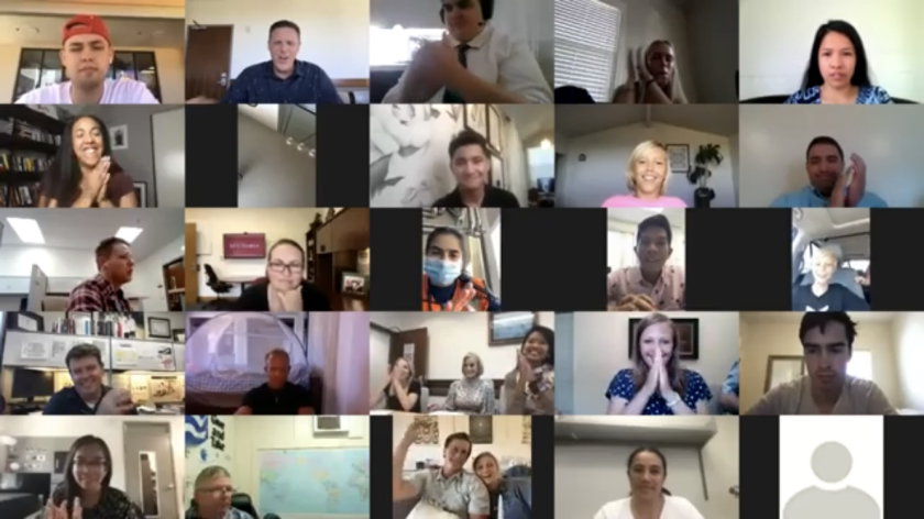Screenshot of participants, judges, mentors and viewers clapping during a Zoom event.