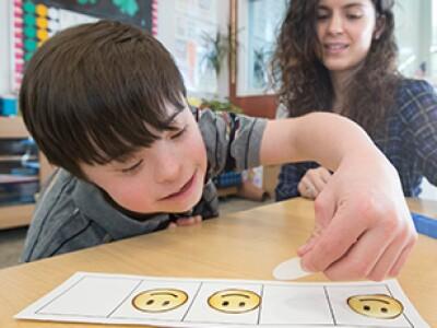 A teacher helping a student self monitor