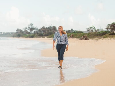 Martha Christensen walks on the beach in Laie with her J-Slips.
