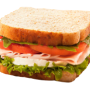 photo of a ham sandwich with tomatos, cheese, and lettuce