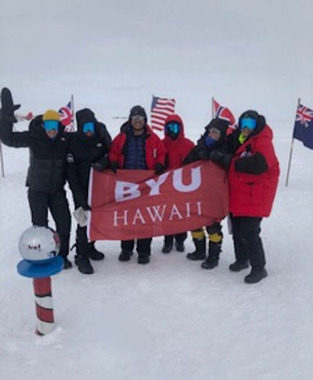 Ingley and his team hold a BYU–Hawaii flag in Antarctica.