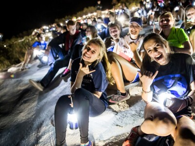 Students celebrate a night hike to the Y
