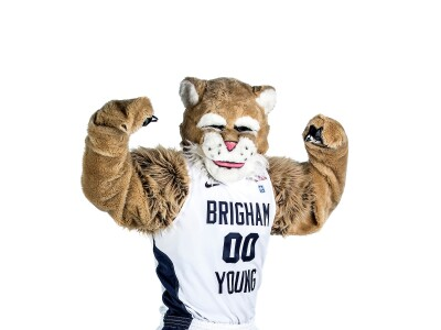 Cosmo the Cougar mascot flexes its biceps