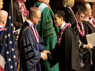 President Tanner congratulates a BYUH graduate