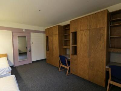 A photo of a hale bedroom with desks