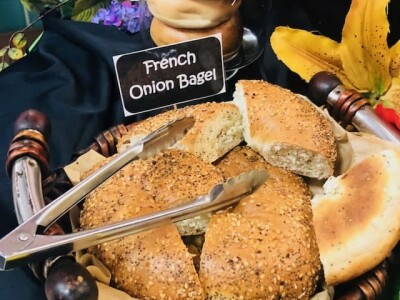 A basket of french onion bagels at the bagel station.