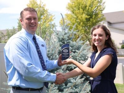 Evan Bingham receiving award