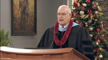 Elder Paul V. Johnson in academic robes