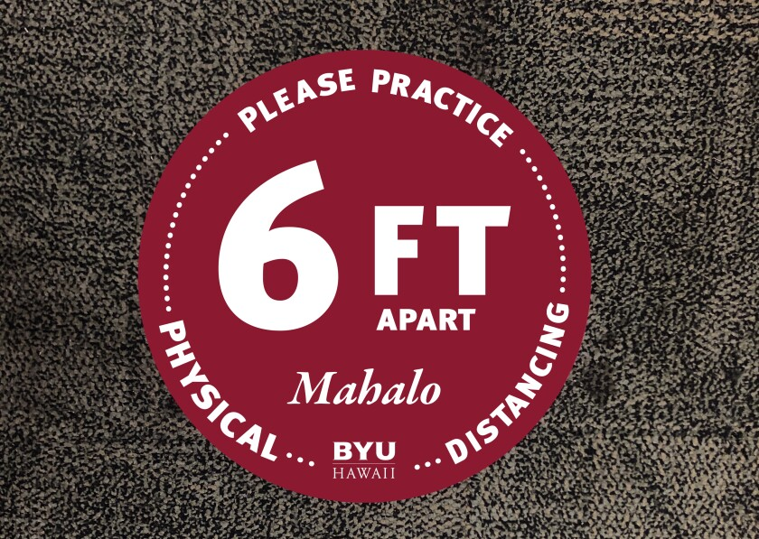 "BYUH's physical distancing floor sign on carpet reminding patrons to keep 6ft apart. Sign reads ""Please practice physical distancing. 6 ft apart. Mahalo. BYU–Hawaii."""