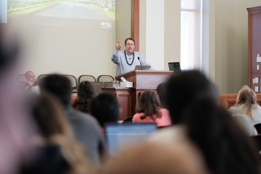 Steve Lundgren lectures to HTM students and faculty at the podium