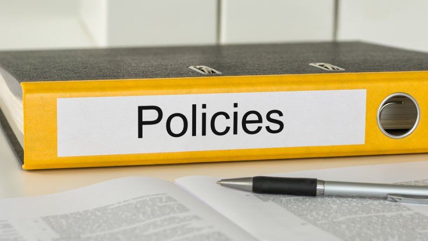 Image of a binder labeled policies.