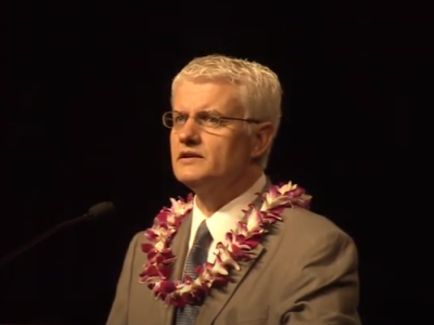 Phillip McArthur speaking at devotional.PNG