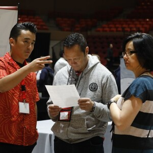 A student talking to two external company representatives