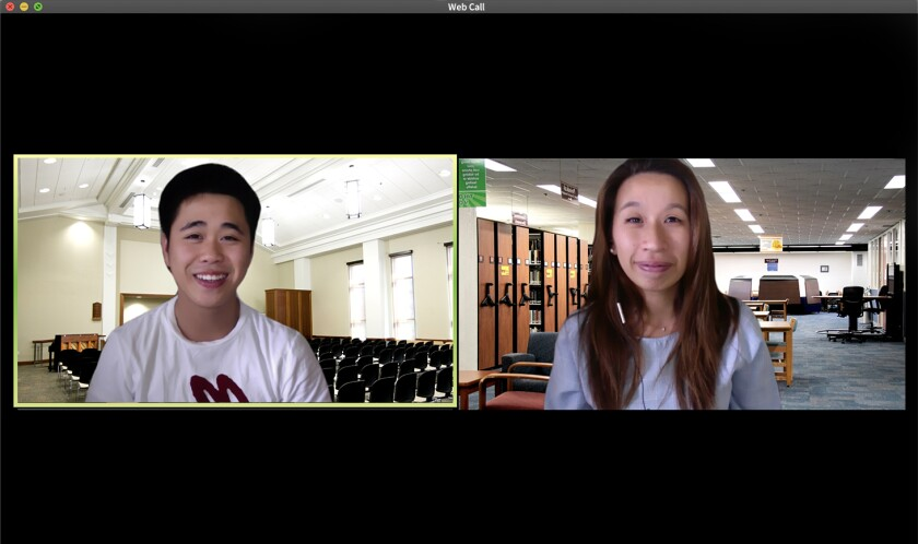 Two students having a web call using virtual backgrounds