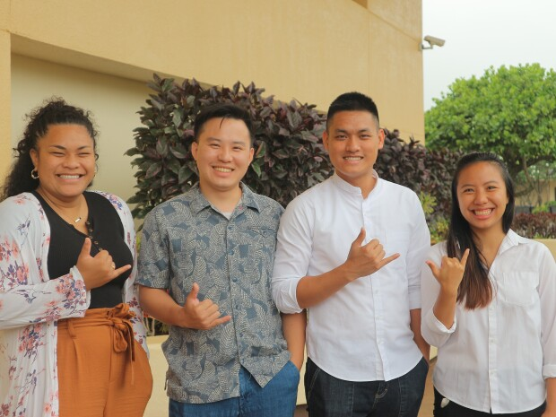 Four career mentors are smiling with a shaka sign