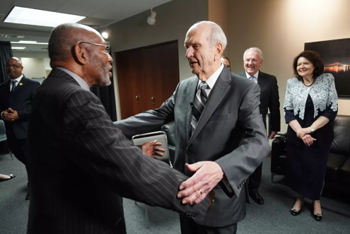 President Russell M. Nelson embraces the Rev. Amos C. Brown