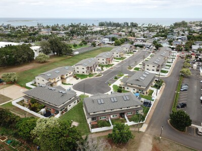 An areal side view of Na Hale  Kumu Area A. The construction work is complete. Temple View Apartments are on the left-hand side and the Temple is on the right-hand side of the photo. Naniloa Loop can be seen right after Area A.