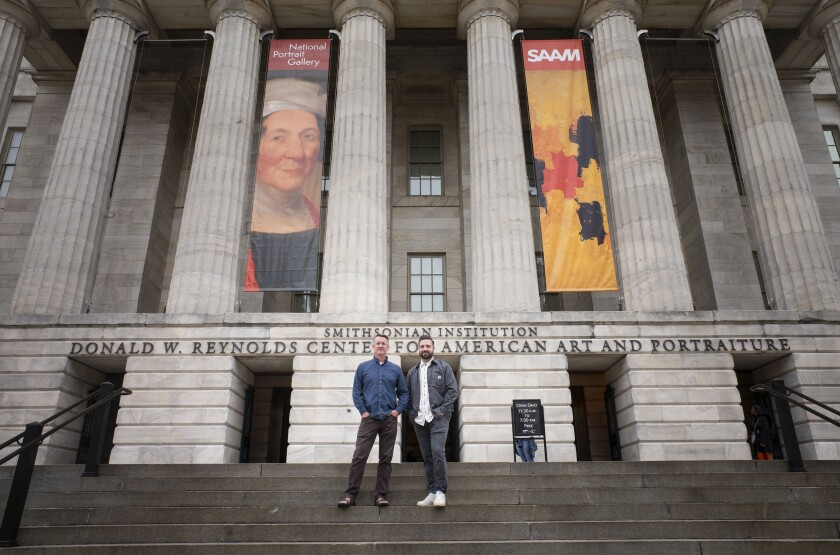 Paul Adams and Jordan Layton pose for a picture while standing on the steps of the Smithsonian Museum.jpg