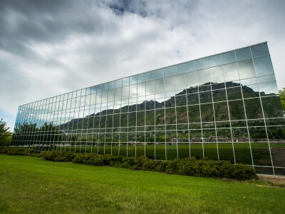 Image: Reflection of Y Mountain on the Harman Building.