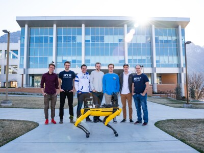 Novva Data Centers' BYU Capstone team with Boston Dynamic's SPOT®robot in front of BYU Engineering building, BYU Provo campus.