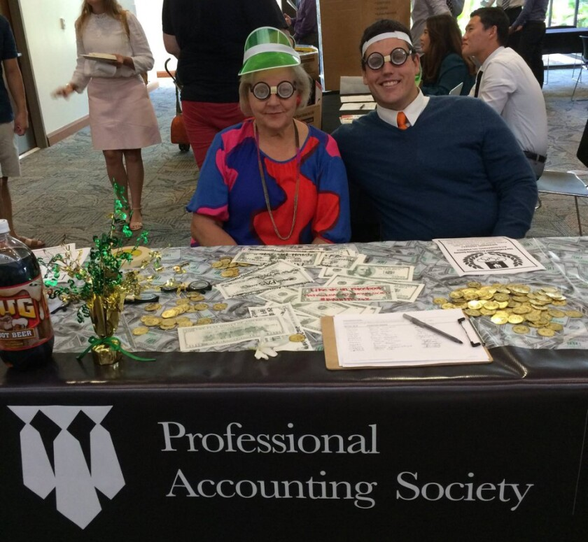Hannonen with student at the Professional Accounting Society stand at BYUH