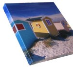 an image of a picture of a small house on sand
